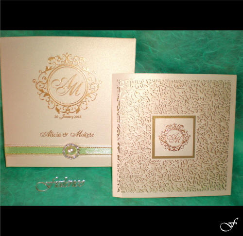 Gold Embossed Laser Cut Wedding Invitation by Fralenco